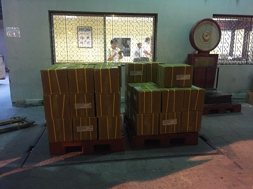 Omani Women books weighing in at Muscat Airport cargo office. web